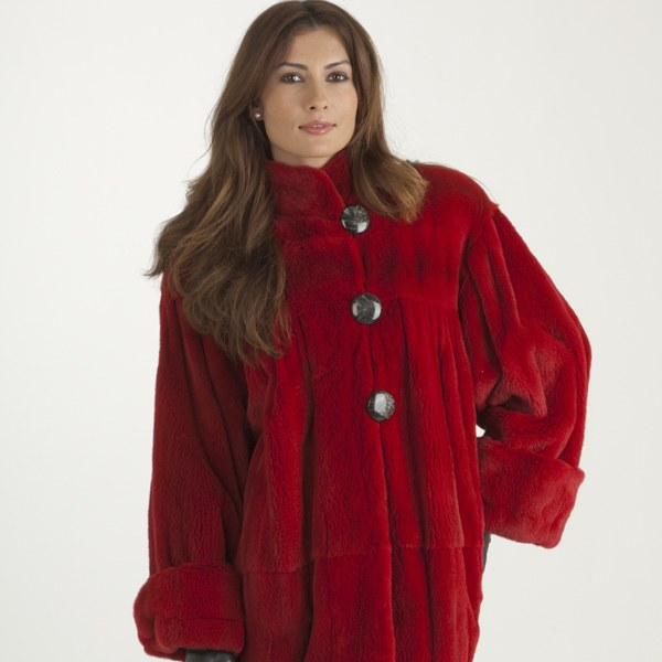 Model in a red sheared mink fur coat